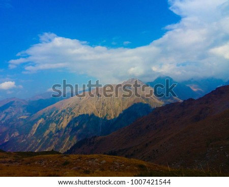 summer landscape of nature Almaty with a view of the mountains waterfalls sky firs and rivers