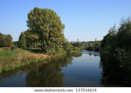 summer landscape of river and green trees and bushes - stock photo