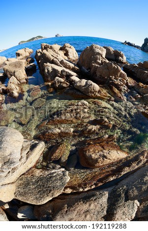 Summer landscape of rocky sea coast. Japan sea. Fish-eye lens. - stock photo