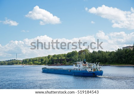 Summer landscape of the Volga River and the cargo ship, Russia