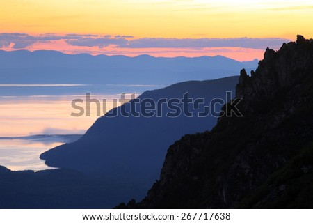 summer landscape sunset over the lake Baikal, the view from the mountain