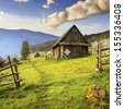Summer landscape with a lonely house. Mountain village in the Ukrainian Carpathians.  - stock photo
