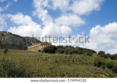 summer landscape with ancient Greek temple of Venus, Segesta village, Sicily, Italy - stock photo