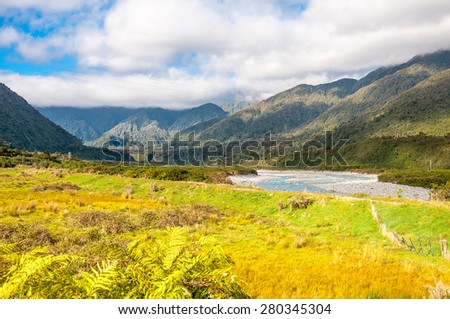Summer Landscape with Green Field and Blue Sky, New Zealand - stock photo