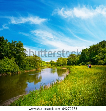 summer landscape with river and blue sky - stock photo