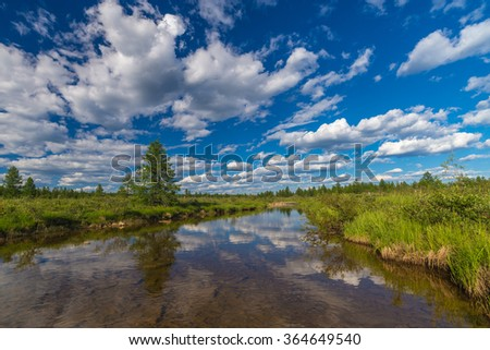 Summer landscape with river, forest, cloudy sky  - stock photo