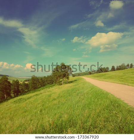 summer landscape with road on hills - vintage retro style