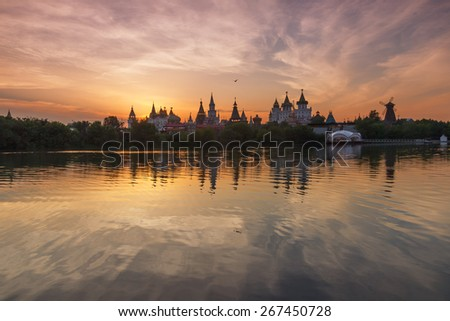 Summer landscape with russian Kremlin at sunset with interesting sky. Izmailovo Park and the Kremlin, Moscow, Russia - stock photo