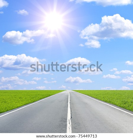Summer landscape with sun and old road