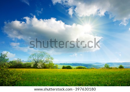 Summer landscape with sunshine and clouds.