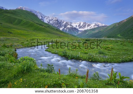 Summer landscape with the mountain river. Evening after sunset. Caucasus. Zemo Svaneti, Georgia - stock photo
