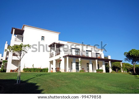 Summer landscape with white luxury resort villa on blue sky background(Portugal) - stock photo