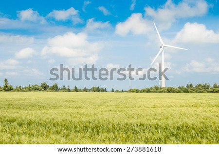 Summer landscape with wind generators - stock photo