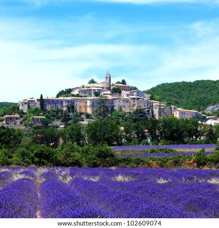 summer lavender field and the old town of Banon in Provence, France - stock photo