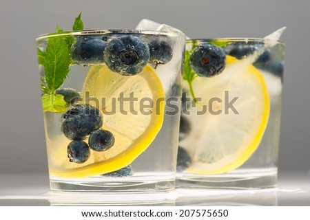 Summer lemonade with blueberries, lemon and mint. - stock photo