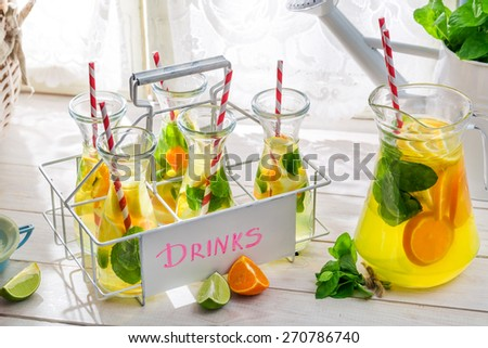 Summer lemonade with straw and fruits
