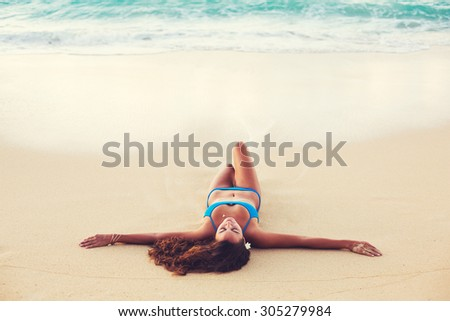 Summer Lifestyle, Beautiful Happy Carefree Young Woman Relaxing on the Beach at Sunset - stock photo