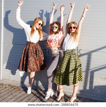 Summer lifestyle portrait of tree girls going crazy, screaming, laughing having fun together, put hands up to the sky.wearing white tops and sunglasses, ready for party, joy, fun.summer friends - stock photo