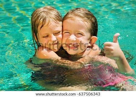 Kid hug stock images royalty free images vectors - Swimming pool girl christmas vacation ...