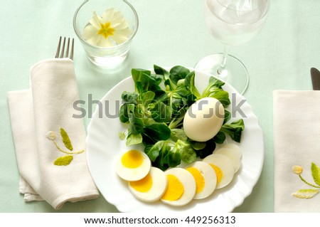 summer lunch, lamb's lettuce and boiled eggs, natural light