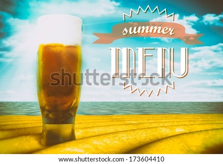 Summer menu sign with beer glass on beach - stock photo