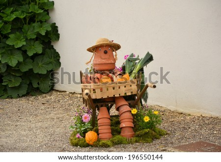 summer mood, original decorations for the garden, a small scarecrow - stock photo