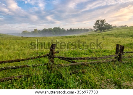 Summer morning and field along the Blue Ridge Parkway in North Carolina - stock photo