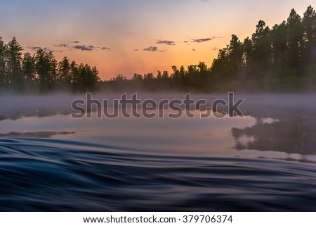 Summer morning landscape with river, forest and fishing  - stock photo