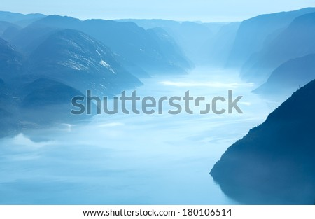 Summer morning misty view from Preikestolen massive cliff top (Norway, Lysefjorden) - stock photo