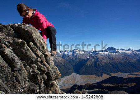 Summer mountain climbing - stock photo