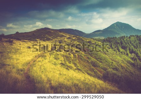 Summer mountain landscape. Hiking trail in the hills. Filtered image:cross processed vintage effect. - stock photo