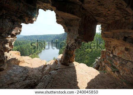 Summer mountain landscape Idrissova Cave in the Urals, the river and the forest on a sunny day the view from the hill - stock photo