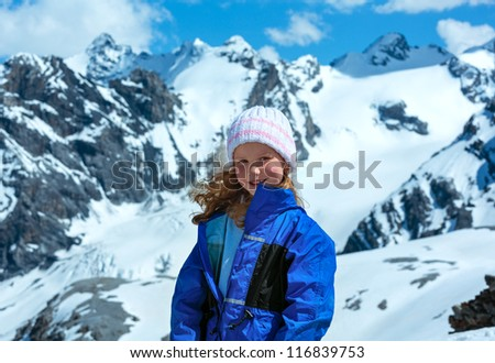 Summer mountain view from Stelvio pass with snow on slope (Italy) and girl portrait.