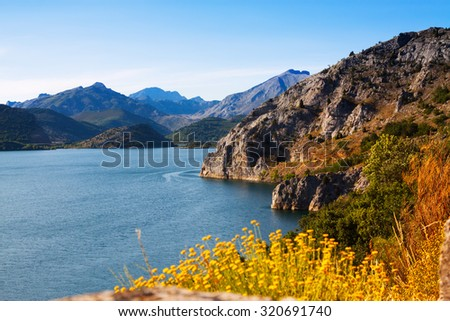 Summer mountains landscape with lake.   Barrios de Luna reservoir  in Leon.  Spain  - stock photo