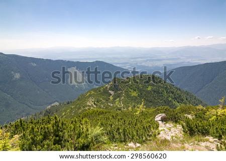 Summer mountains - view from ridge of West Tatras to Liptov valley and Low Tatras. Slovakia, Europe. - stock photo