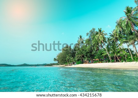 Summer nature scene. Tropical beach with sea, blue sky and palm trees, Kood island is located in the South East part of Thailand. Beautiful sea and white sand beach.  - stock photo