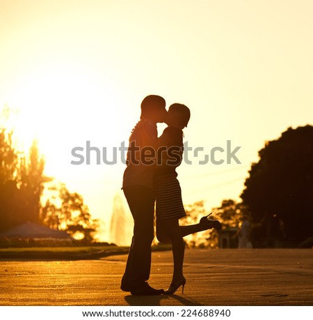 Summer of our love. Young couple having date on sunset background.  - stock photo