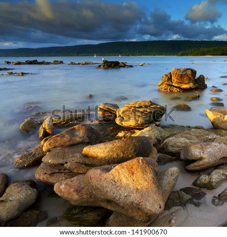 Summer of rocks in the sea at evening light, The natural landscape