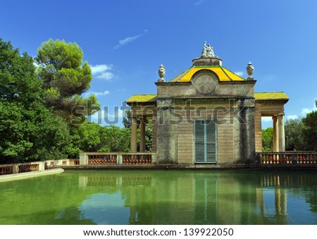 Summer old pavilion of pond water. Parc del Laberint. Barcelona. Spain - stock photo