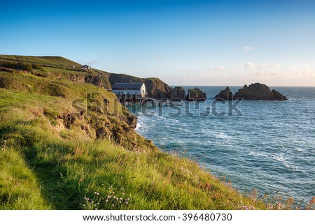 Summer on the Cornwall coast at Long Cove near Padstow - stock photo