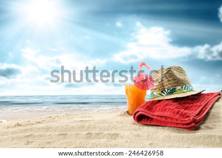 summer orange juice and towel of red  - stock photo