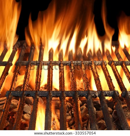 Summer Outdoor BBQ Party, Picnic Or Cookout Concept With Empty And Clean Hot Flaming Charcoal Cast Iron Grill And Vibrant Flames Of Fire Isolated On Black Background - stock photo