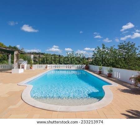 Summer outdoor pool in the garden. For swimming and recreation. - stock photo