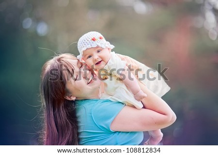 Summer outdoor Portrait of happiness mother with baby girl