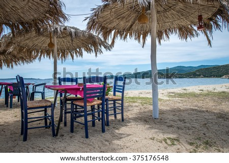 Summer outdoor terrace cafe on sand beach