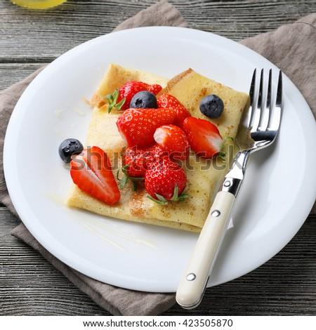 summer pancake with fresh berries, food closeup  - stock photo