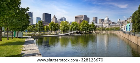 Summer panorama of downtown Montreal viewed from the park, showing the old Bonsecours Market building, which was the public city market for over 100 years.  - stock photo