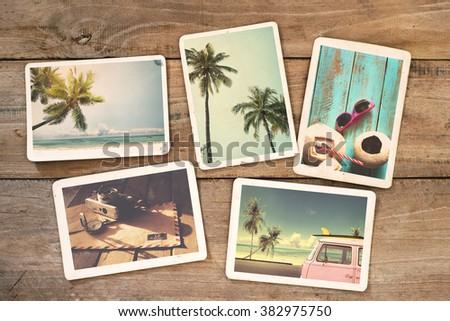 Summer photo album on wood table. instant photo of polaroid camera - vintage and retro style - stock photo