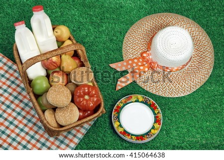 Summer Picnic Concept With Straw Hat And Food Basket On The Fresh Green Lawn Background, Overhead View - stock photo