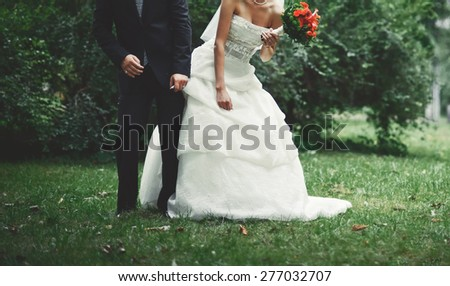 Summer picture of happy wedding couple outside.